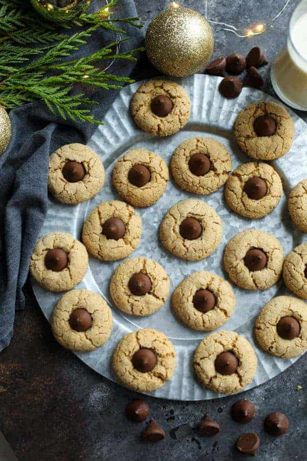 Overhead view of Gluten Free Peanut Butter Blossoms on a silver tray