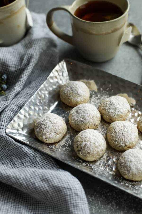 Gluten-free Russian Tea Cakes on a silver platter.