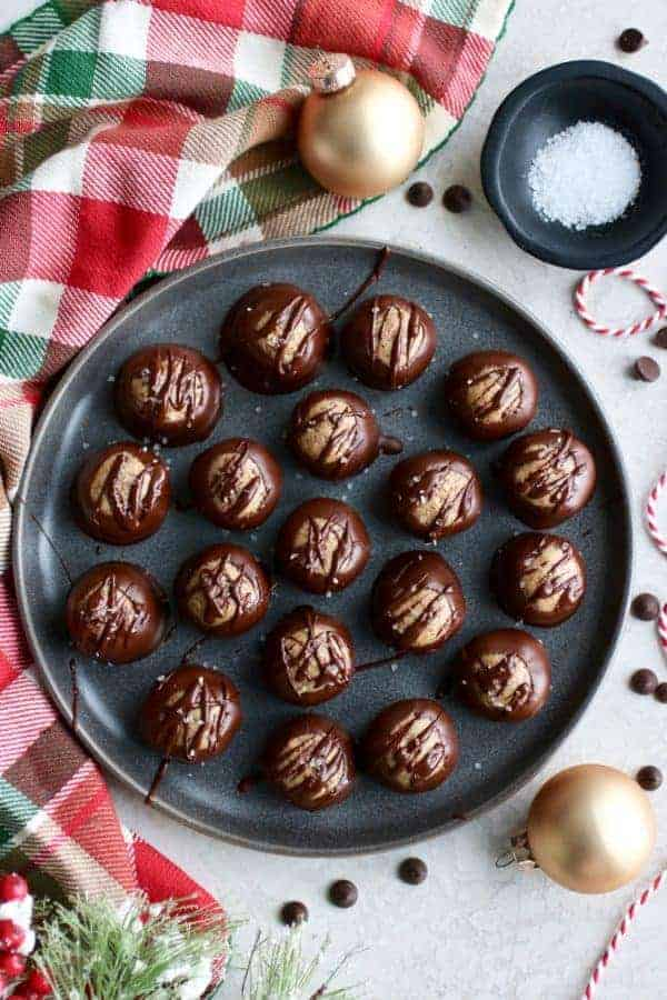 Overhead view of Healthy Buckeyes (Peanut Butter Balls) on a gray tray