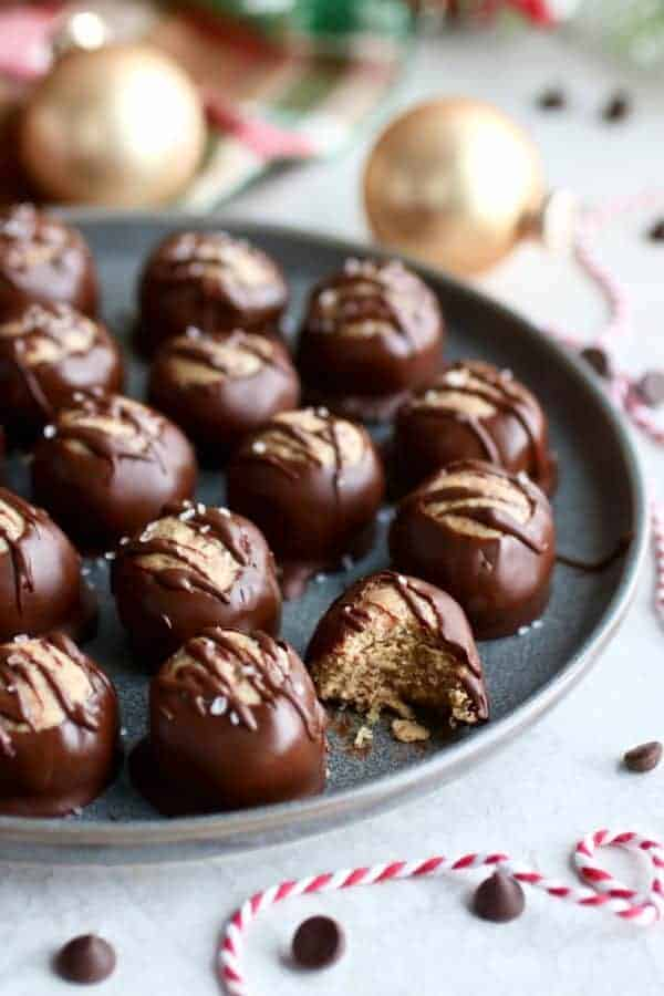 Healthy Buckeyes (Peanut Butter Balls) on a tray with one missing a bite
