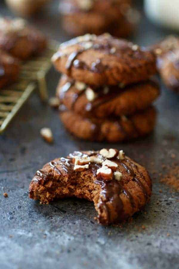 One of the Paleo Soft Batch Ginger Molasses Cookies with a bite taken out of it.