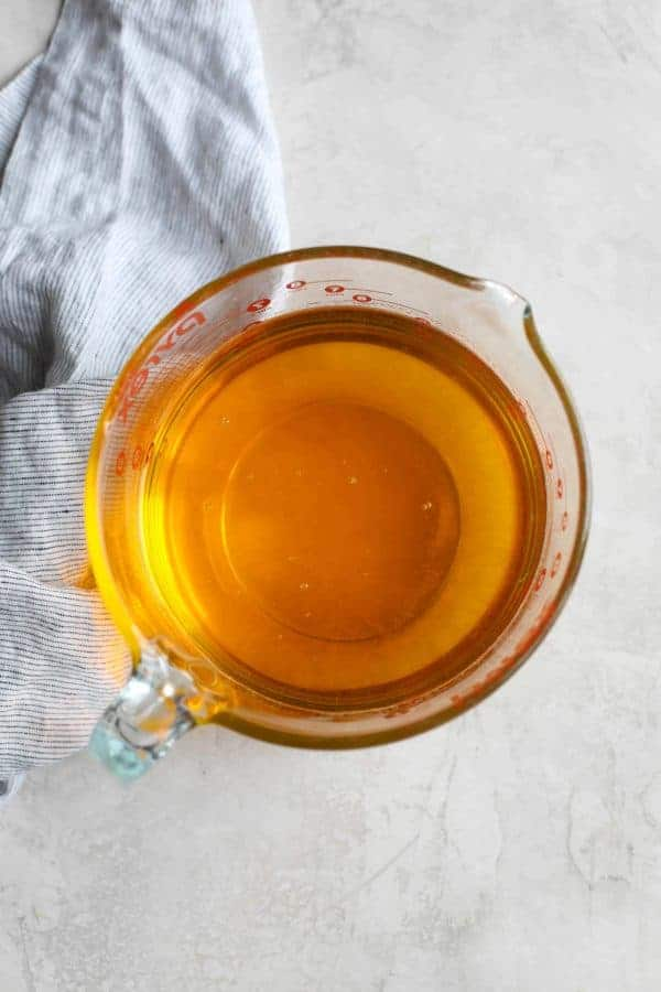 Arial view of liquid ghee in a large measuring cup.