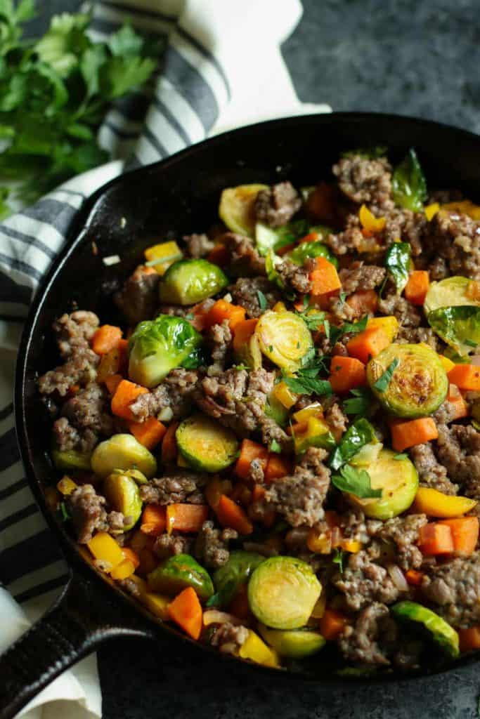 Cast iron skillet filled with Brussels Sprouts Sweet Potato Hash