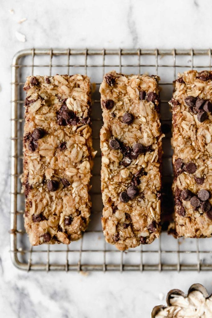 overhead picture of chocolate chip peanut butter granola bars on wire cooling rack