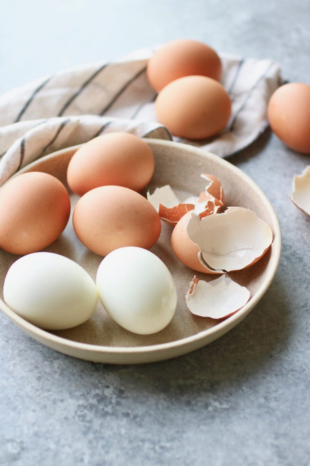 Freshly hard-boiled eggs with easy-peel shells in a shallow bowl