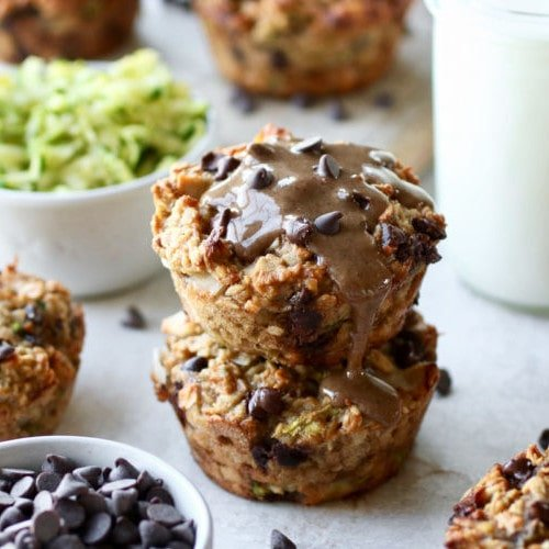 Two zucchini oatmeal breakfast muffins stacked on top of each other as part of 6 freezer breakfast recipes