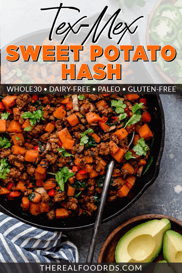 Sweet potato hash with taco meat in a cast iron skillet and topped with fresh cilantro.