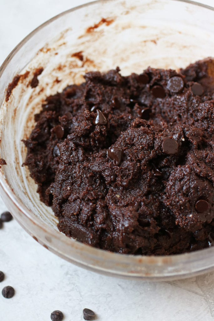 Photo of Chocolate Peanut Butter Protein Cookie dough in a clear bowl.