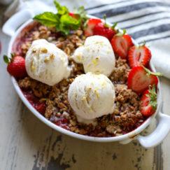 Grain Free Strawberry Rhubarb Crisp topped with vanilla ice cream