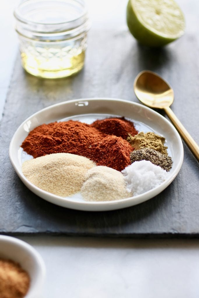 Small white plate holding the spices for the ultimate BBQ Rub