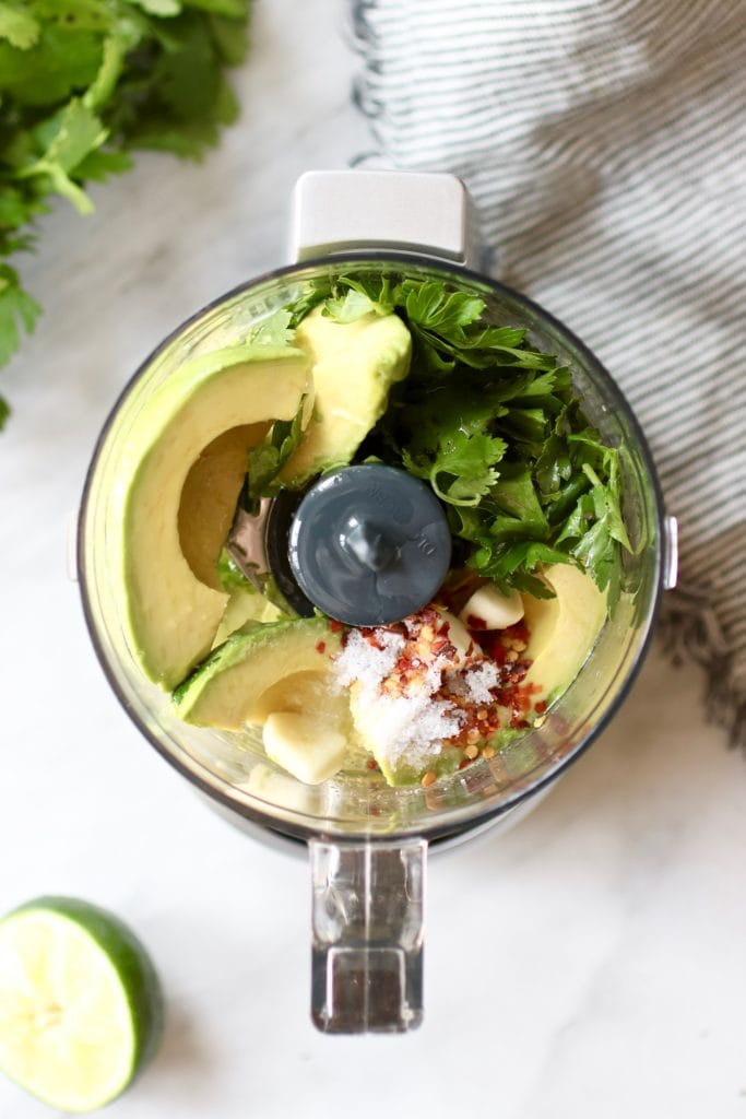 Photo of Avocado Green Sauce ingredients in a food processor