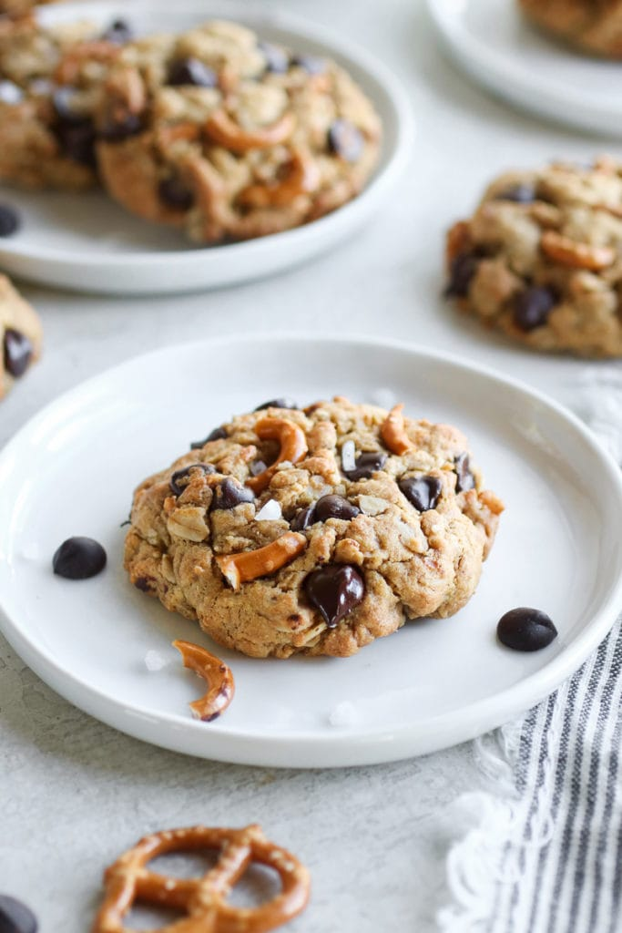 A Peanut Butter Chocolate Chip Pretzel Cookie on a white plate...calling your name!