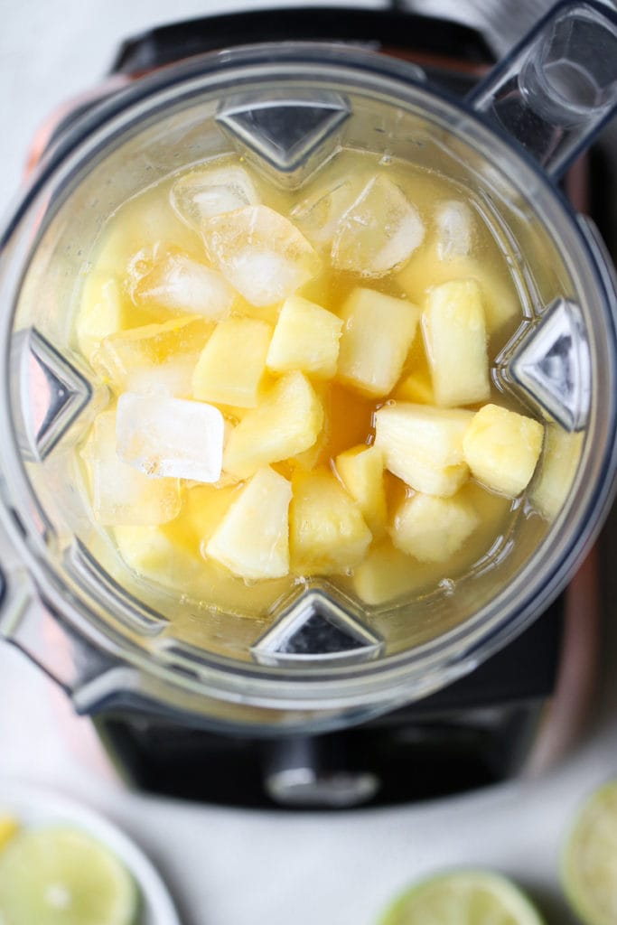 Overhead shot of blender filled with ingredients for the Frozen Pineapple Margaritas
