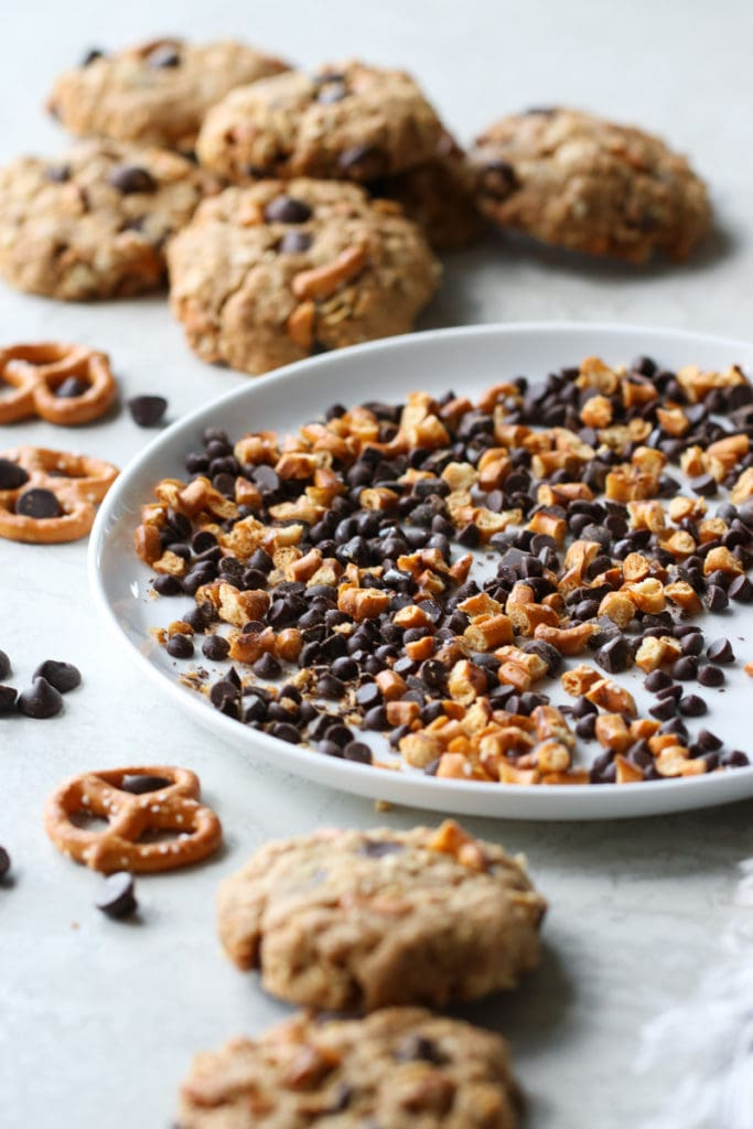 Plate of crushed pretzel bits and chocolate chips for the Sweet & Salty Ice Cream Sandwiches