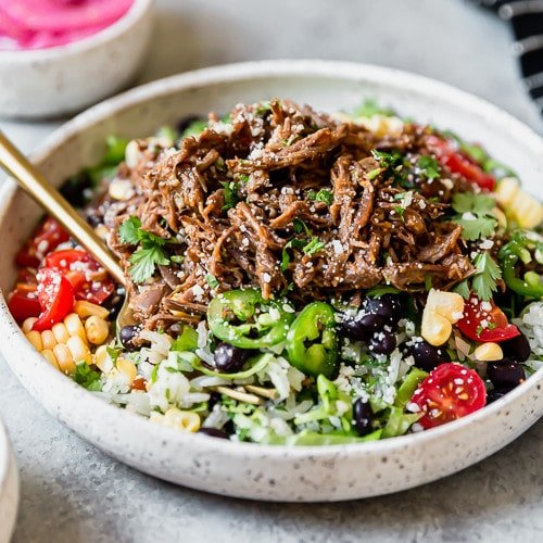 Instant Pot Beef Barbacoa served on a stone plate