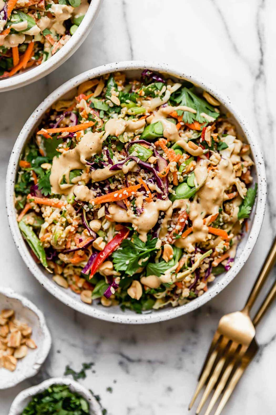 Thai Peanut Quinoa Salad Served in a White Stone Bowl