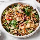 Thai Peanut Quinoa Salad Served in a White Stone Bowl