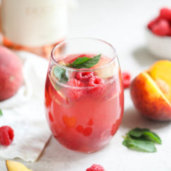 Cheers to summer! Raise a glass of our Raspberry-Peach Rosé Sangria to celebrate the sweetest things in life.