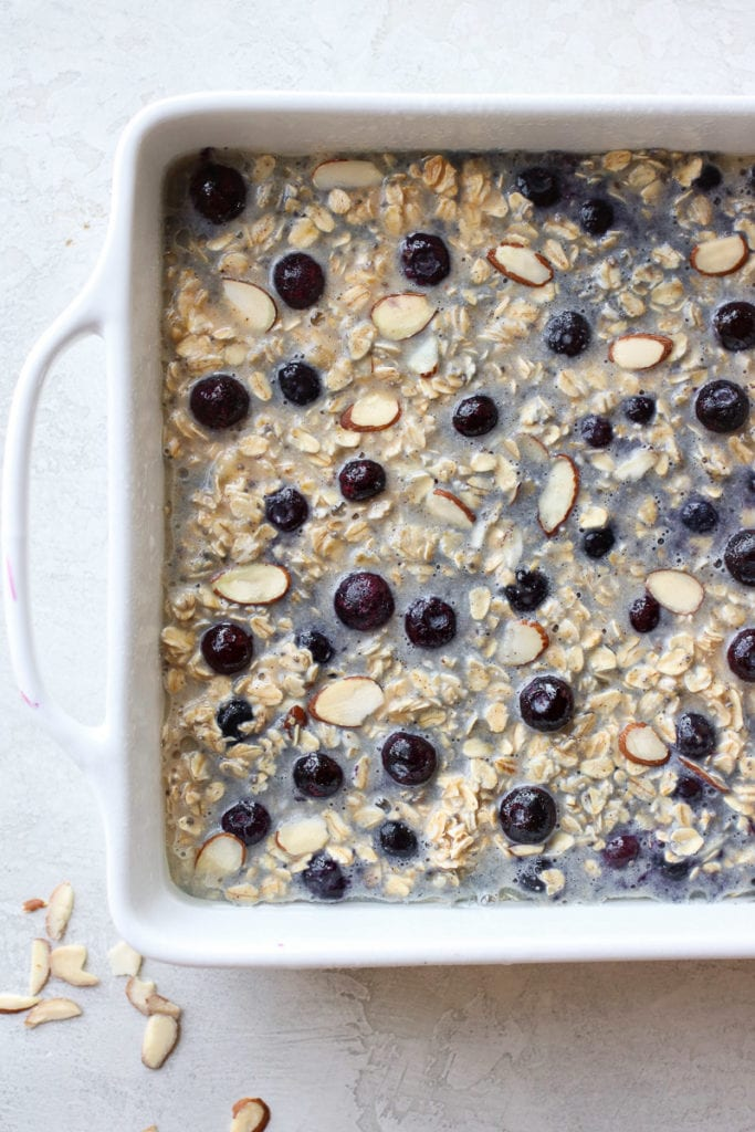 Blueberry Baked Oatmeal in a white dish before going in the oven.