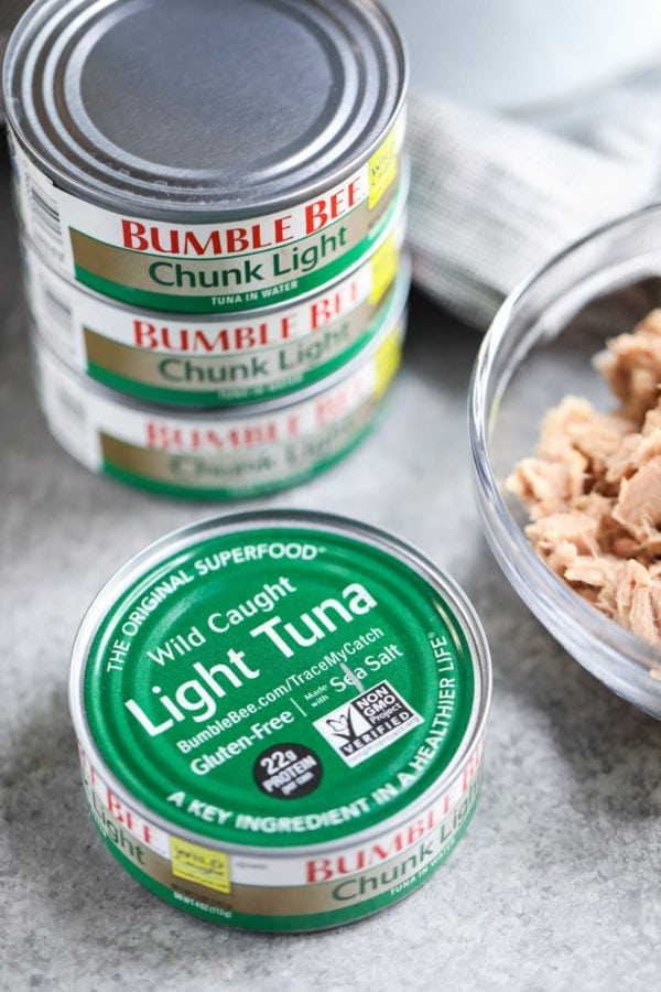A stack of cans of Bumble Bee Chunk Light tuna in water