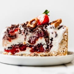 A slice of Strawberry Pretzel Ice Cream Pie plated and ready to serve.