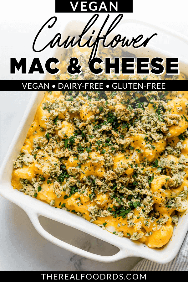 Creamy Vegan Cauliflower Mac and Cheese in a white baking dish with a cashew and herb topping.