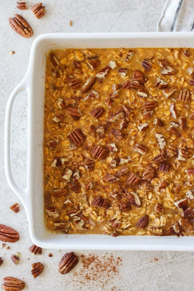 Photo of the Pumpkin Baked Oatmeal in a white square dish before going into the oven to bake.