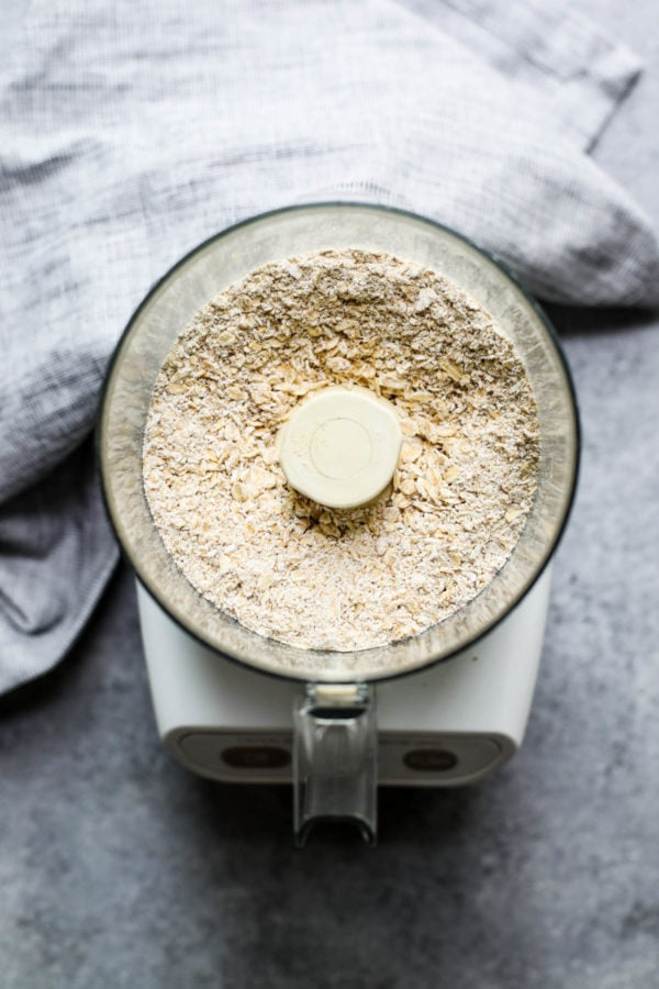 overhead view of oats being processed in a food processor