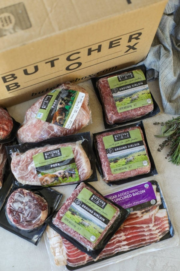 A variety of quality meat from Butcher Box packaged in front of a ButcherBox box