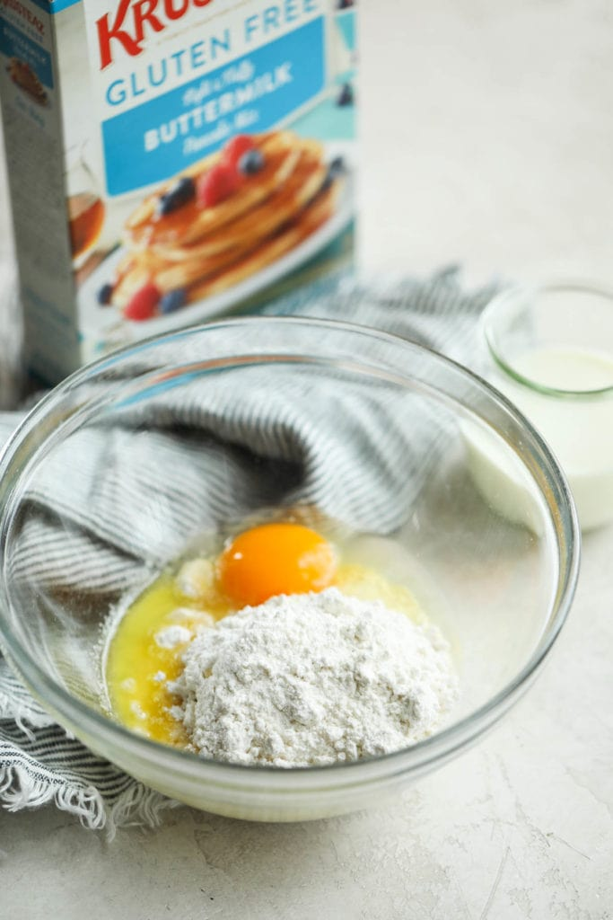 The ingredients for the base of a Western-style breakfast casserole in a glass mixing bowl.