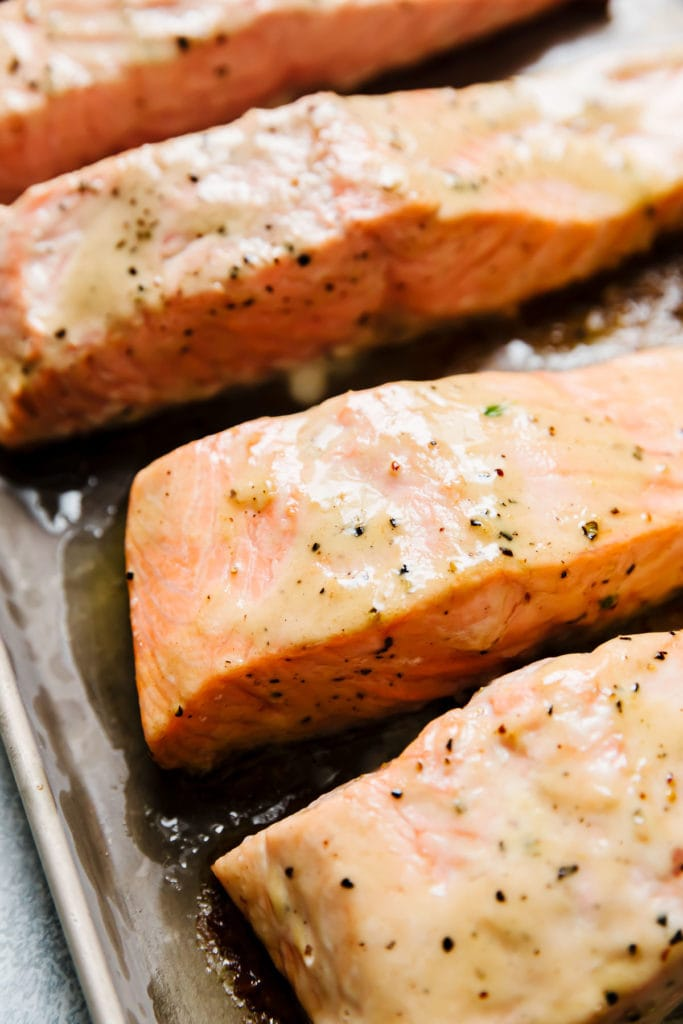 Perfectly baked salmon fillets with caesar dressing baked into the top