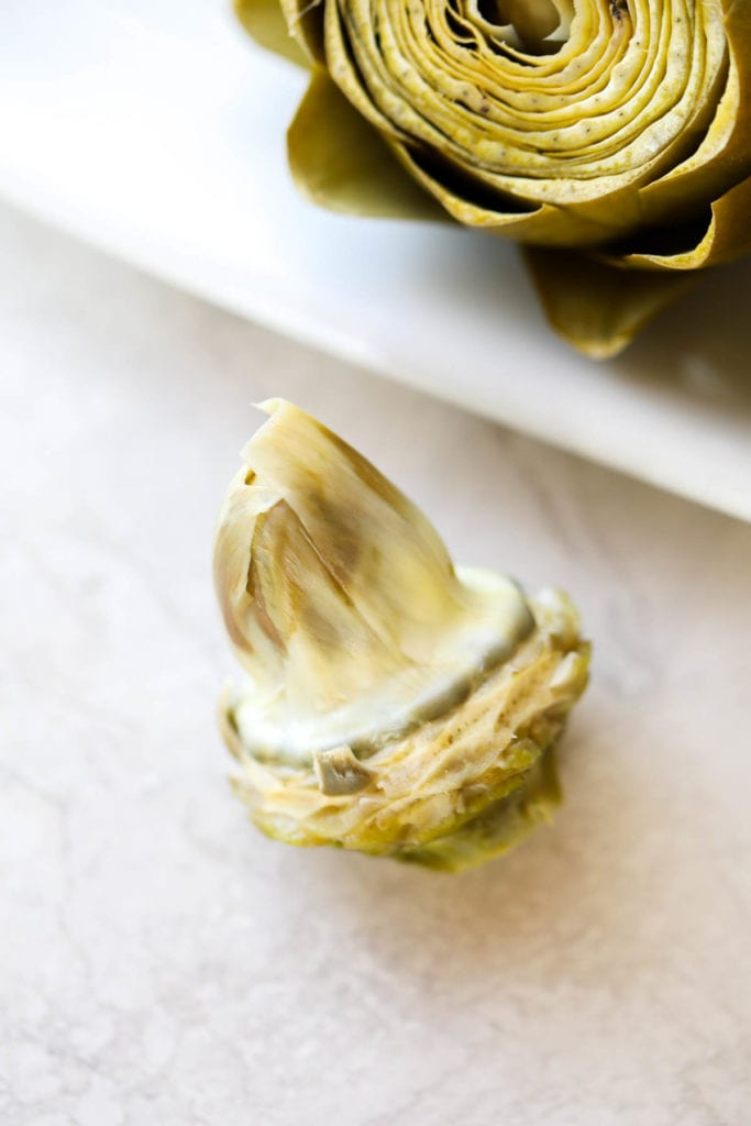 The inner choke of the artichoke laying on the counter