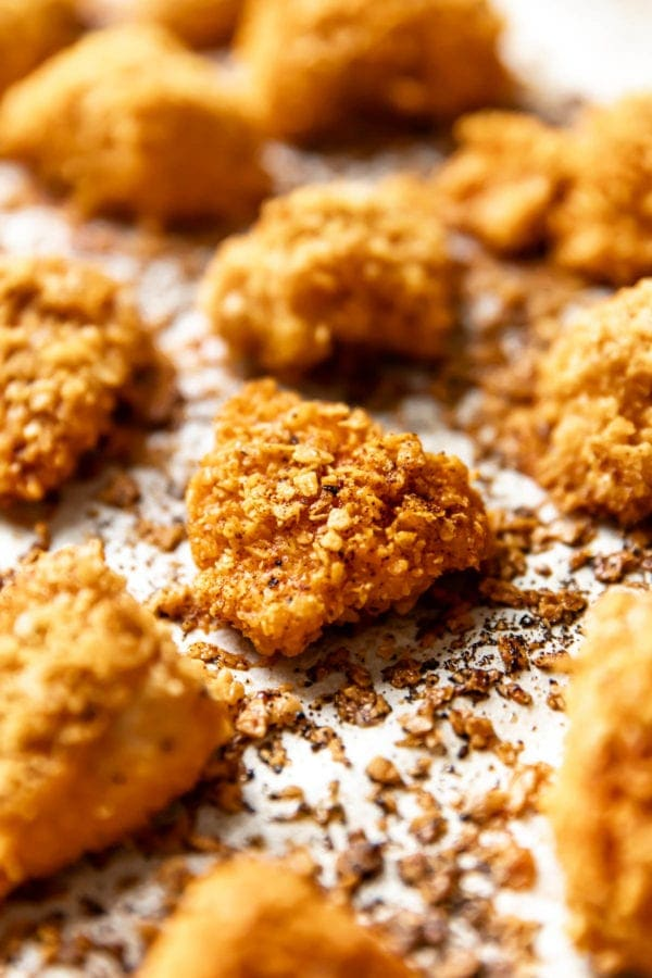 Perfectly baked golden homemade baked chicken nuggets on a baking sheet