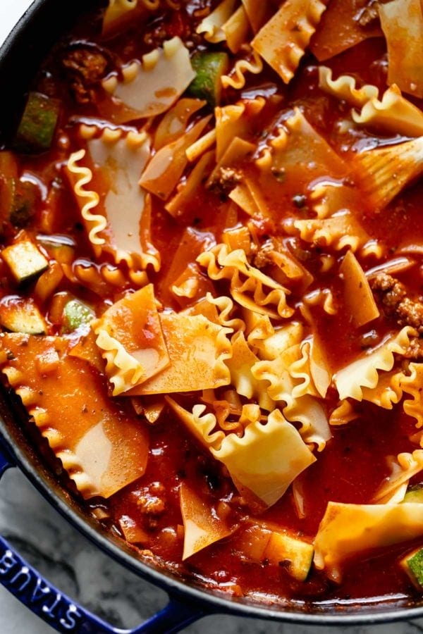 Cooking process shot of stirring lasagna noodles into Easy Skillet Lasagna