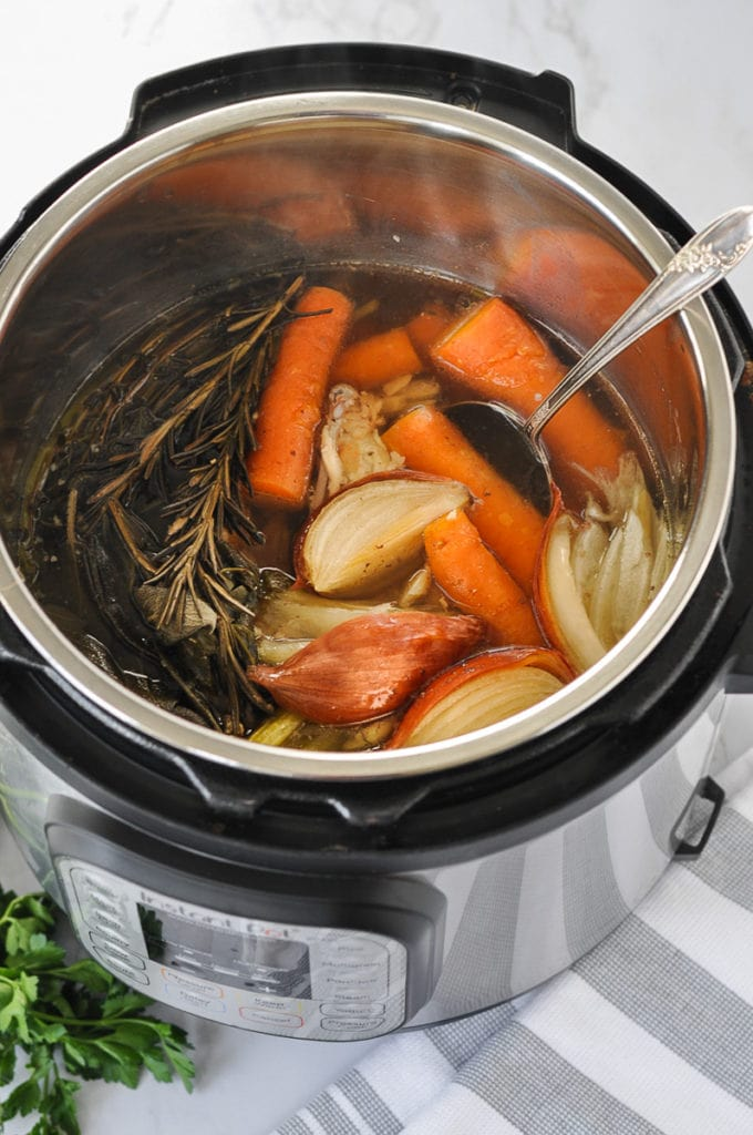 Freshly made homemade chicken bone broth in an Instant Pot