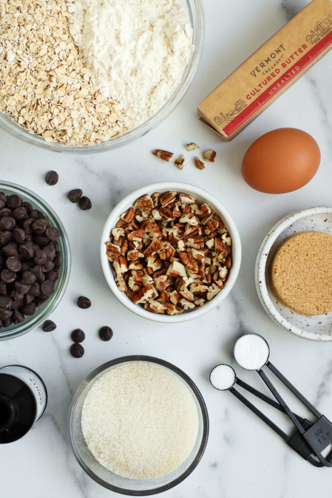 All ingredients for gluten-free oatmeal chocolate chip cookies displayed on a counter