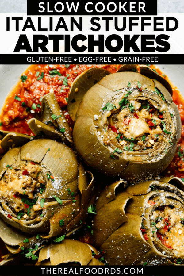 Slow Cooker Italian Stuffed Artichokes in homemade marinara sauce on a serving platter