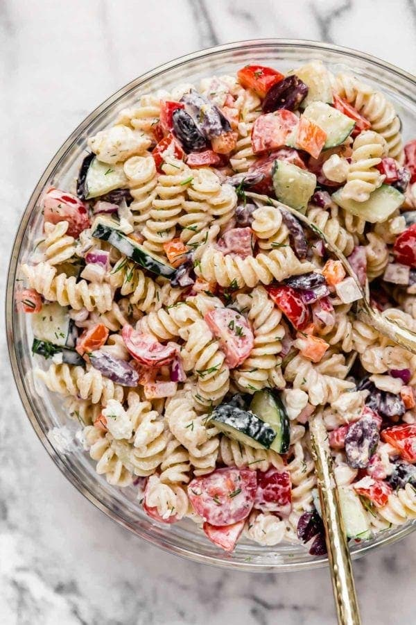 Creamy pasta salad filled with fresh cucumber, tomato, red peppers and fresh dill weed