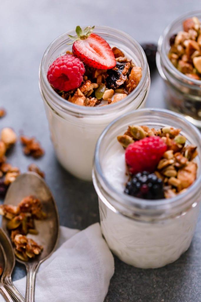 Homemade granola with cinnamon and honey topped on yogurt parfaits