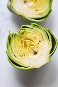 An artichoke cut in half showing the inside layers
