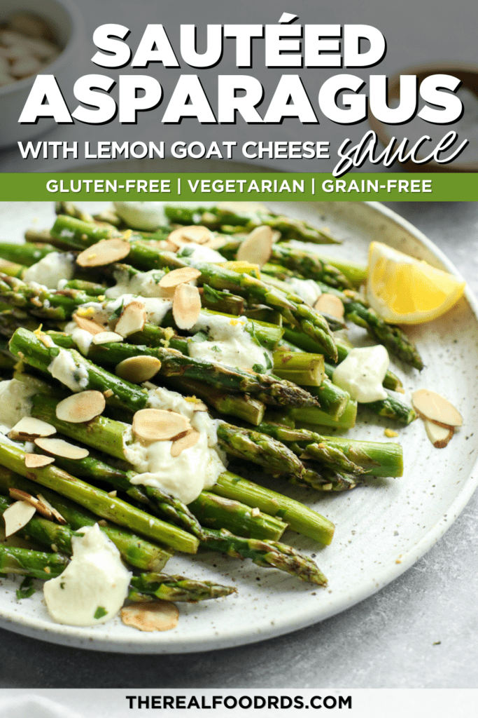 Freshly sautéed asparagus on a speckled plate topped with creamy lemon goat cheese sauce and toasted almonds