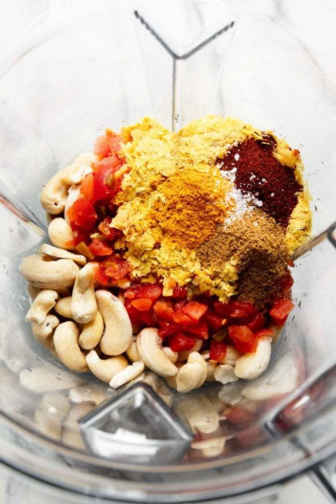 All ingredients for Vegan Nacho Queso in a blender