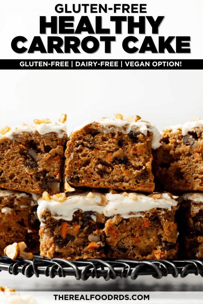 Carrot cake bars frosted with cream cheese frosting cut into bars and stacked on top each other