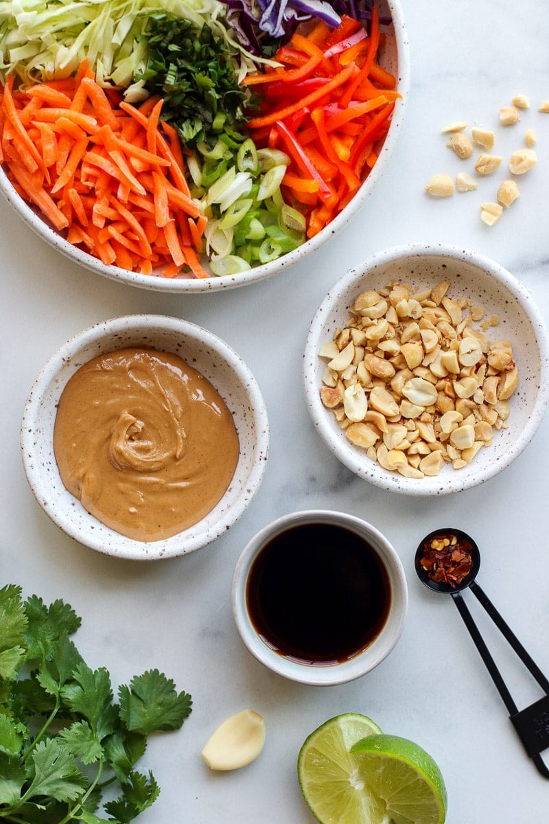 Ingredients for creamy Thai slaw in small bowls