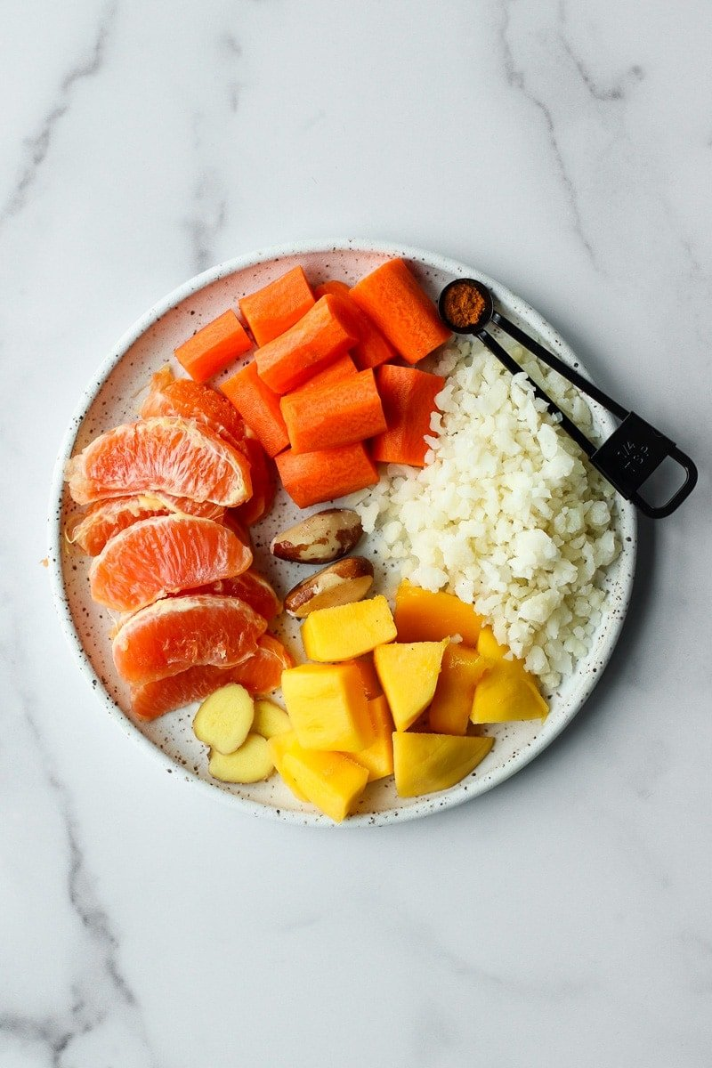 A plate filled with all ingredients for orange smoothie bag