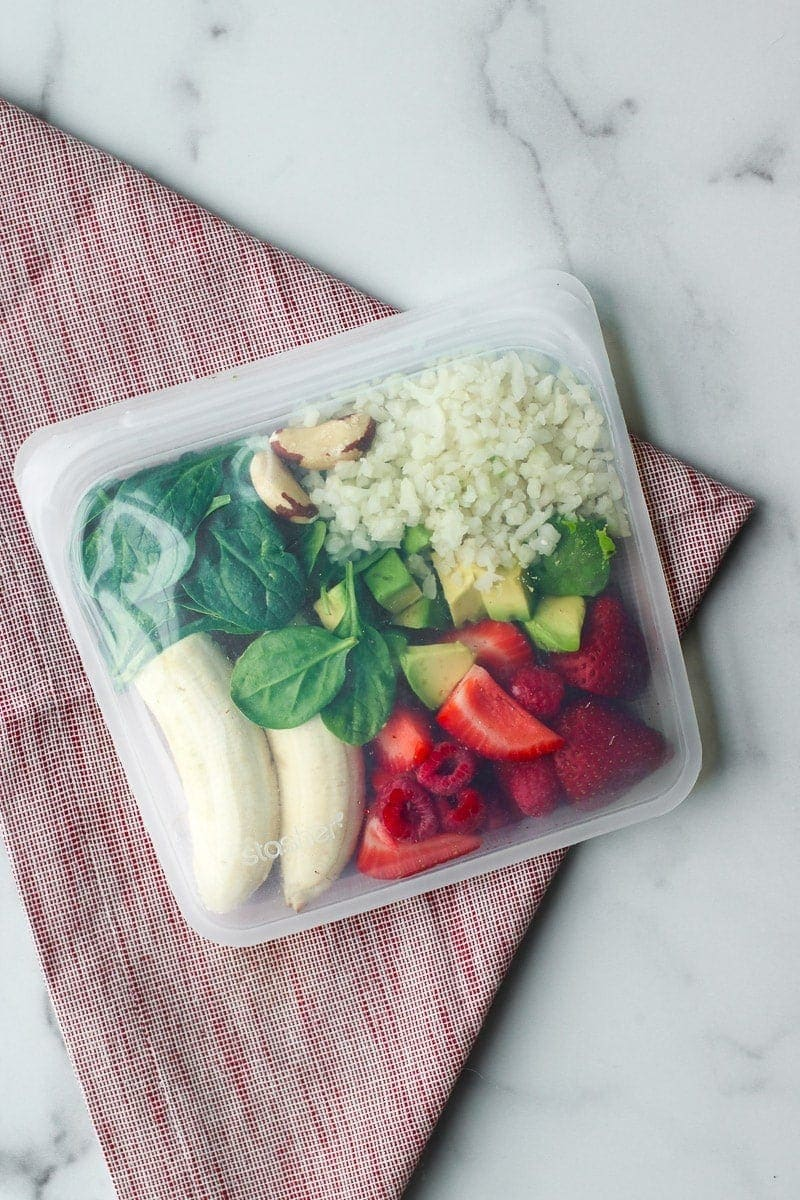 All ingredients for a berry blast smoothie in a reusable freezer bag