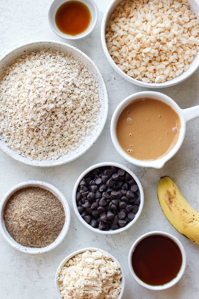 All ingredients for vegan protein bars in small bowls and measuring cups