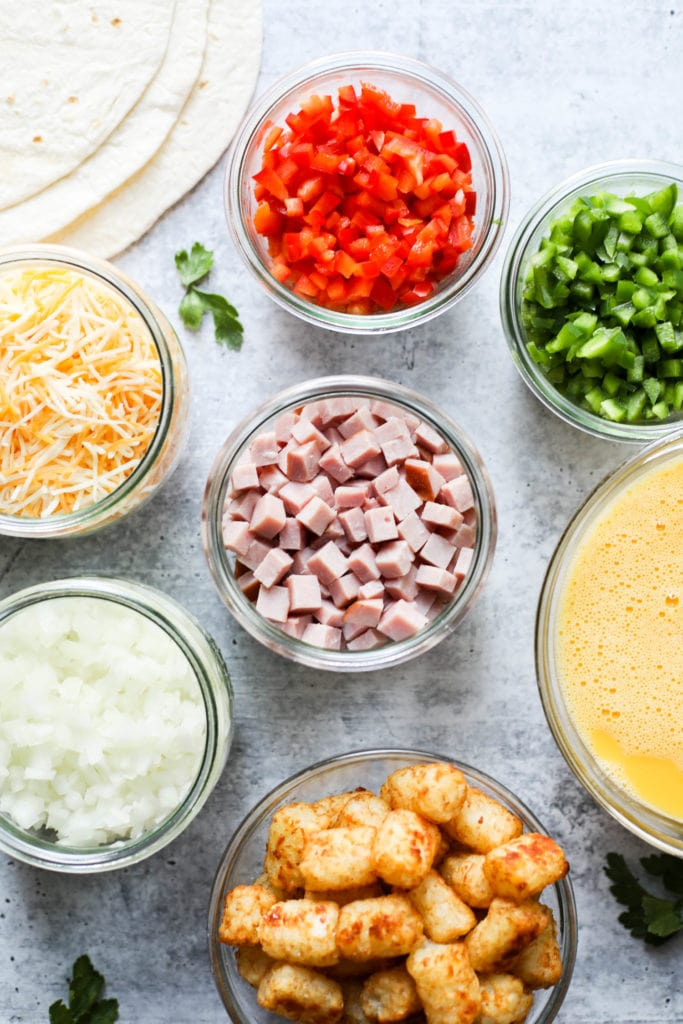 All ingredients for Denver Omelet Breakfast Burrito in small glass containers