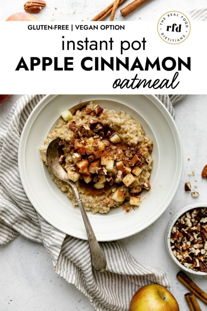 Creamy Instant Pot Oatmeal served in a white bowl topped with apples, maple syrup, and cinnamon.